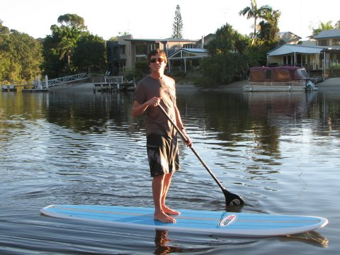 Handsome man stand up paddling