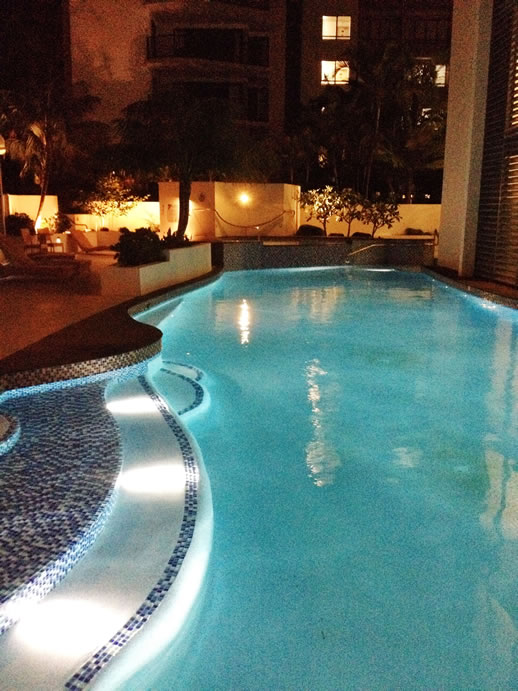 rumba resort caloundra pool by night blue